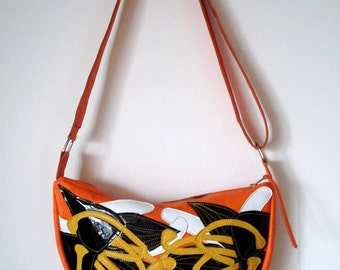 Handmade Crescent Bag in orange leather with black patent and yellow leather appliqued Lilies
