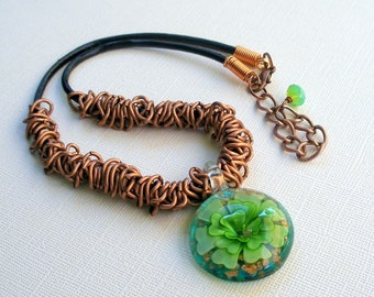 Necklace of leather, copper chain and glass flower pendant