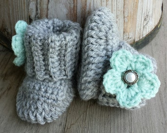 Crochet baby girl boots, in grey with mint flower and pearl button center. size 0 to 3 mo.