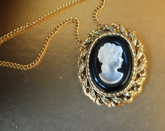 Victorian style vintage 70s gold tone metal necklace with black and white glass cameo pendant.