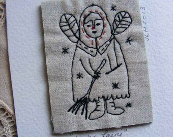 Embroidery artwork  - snow fairy - a story in thread.
