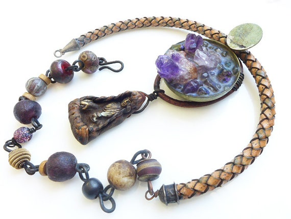 Delight in Solitude. Rustic boho tribal assemblage necklace with amethyst and buddhist talisman.