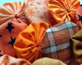 25 pieces of orange fabric yoyos, for Halloween, fall, autumn festival scrapbooking, clothing, hair, wedding embellishment