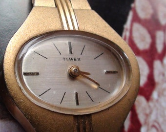 "Timex Great Britain Made  Gold Plated Watch REtro Bracelet Wind Up  Mechanical  and is Working Petite Hand max 6"" Wrist On SaLe Now"