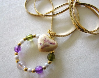Vintage gold and cream heart necklace with purple, green and gold beaded hoop