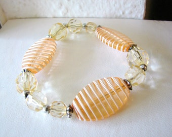 Funky orange and white striped  beaded bracelet peachy accent beads