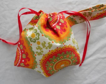 Small Project Bag Wristlet for Sock Knitting, Crochet, and Needlework - Red and Orange Medallions