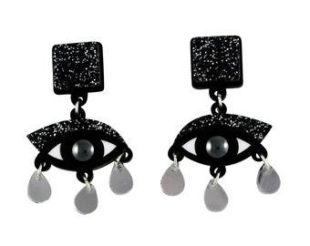 Eyes drop earrings in black glitter perspex