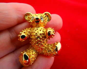 """Vintage gold tone 1.5"""" teddy bear brooch with rhinestone eyes in great condition, appears unworn, heavy and high end"""
