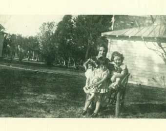 Little Girls Hugging Their Dolls Standing Outside 1930s 40s Vintage Black White Photo Photograph