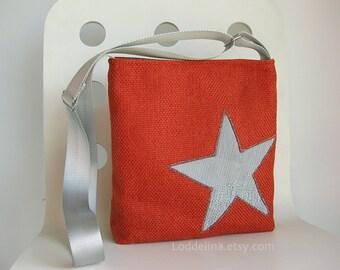 Messenger crossbody bag in burnt orange with light silver grey star applique
