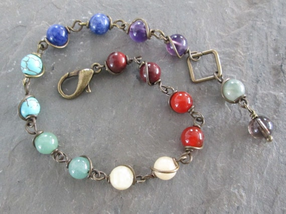 Chakra bracelet - Gemstones to represent the seven main Chakras and Antiqued Brass, wire wrapped