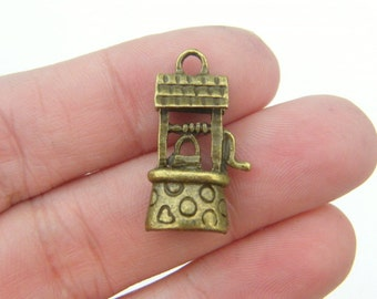 8 Well charms antique bronze tone BC132