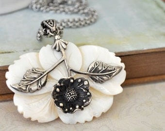 VINTAGE FIND sterling silver necklace with hand carved shell flower on steel chain