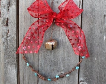 handmade Christmas rusted wire fencing ornament with jingle bell and turquoise beads