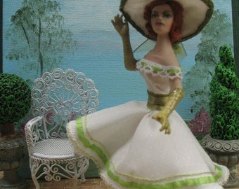 Miniature 1/12th scale porcelain dollhouse doll dressed for a garden party in the 1950's