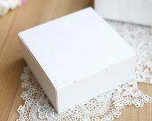 5 white boxes