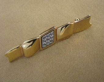 Gold tone vintage Monet ribbon bar pin brooch with rhinestones