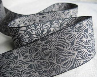 natural ECHO RINGS on BLACK jacquard ribbon