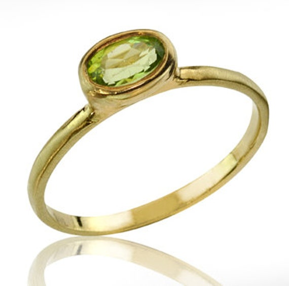 Breathaking Peridot 14k Gold Engagement Ring from Neta Wolpe.