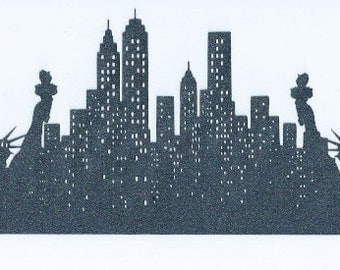 New York skyline bordered by statue of liberty silhouette