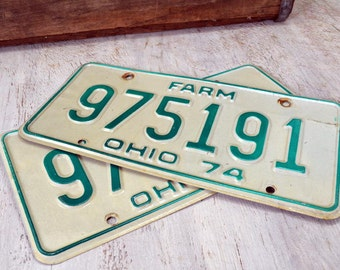 Two Vintage License Plates - 1974 Ohio farm license plate set