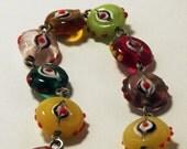 Multicolored glass evil eye bead bracelet