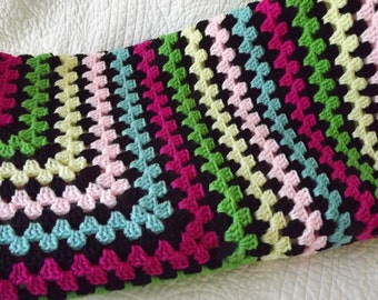 Crocheted Classic Style Granny Square Blanket in Shades of Black Pink Blue Green and Yellow