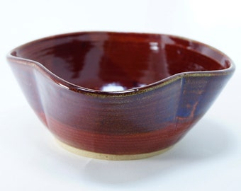 Red and blue speckled petal bowl