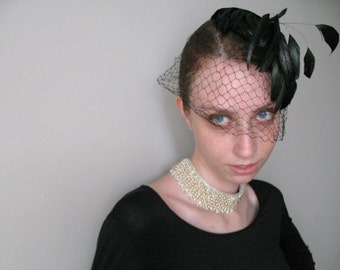 Coque Feather Veiled Head Piece
