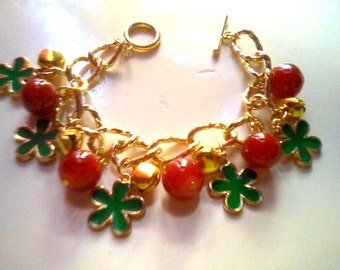 Flower charm bracelet with gold tone bells (red beads/green flowers) (free combined shipping)