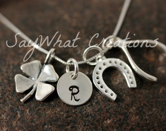 Lucky Charm Necklace Custom Hand Stamped Initial with Horse Shoe Four Leaf Clover and Wishbone Charms