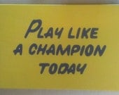 "Play Like a Champion Today Sign     18""x26"" - Standard finish    *Officially Licensed Product*"