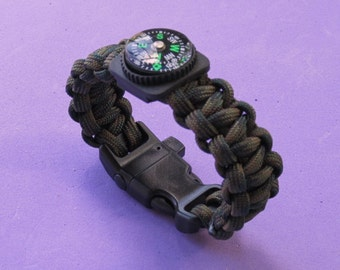 Camo paracord survival bracelet with compass.    Buckle has built in whistle.