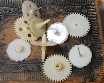Set of 9 Vintage plastic clock parts, gears