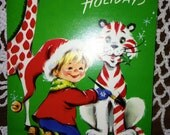C689 Vintage Unused Christmas Greeting Card Boy elf Giraffe Tiger