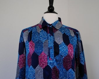 a vintage 70s blouse. multicolored in a hexagon print. sz 10.