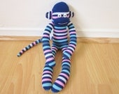 Navy blue and pink striped sock monkey doll plush
