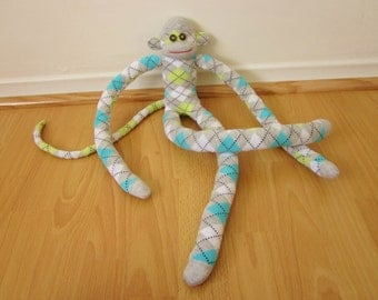 Long legged argyle sock monkey in gray, aqua, and celery green