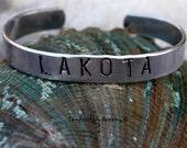 LAKOTA Hand Stamped Cuff Bracelet - Two Feathers Jewelry - Native Inspired Lakota Bracelet - Personalized Tribal Name - Non Tarnish