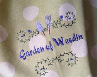 Garden of Weedin' embroidered cotton towel