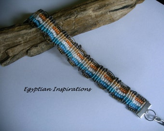Micro macrame bracelet in turquoise, peach, white and taupe. Beaded macrame jewelry
