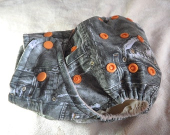 SassyCloth one size pocket diaper with ripped denim PUL print. Made to order.