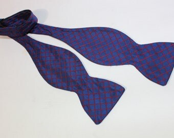 newer vintage -Hanauer- Bow tie. Butterfly shape. Blue Twill - Red grid overlay. All Silk. Made in USA