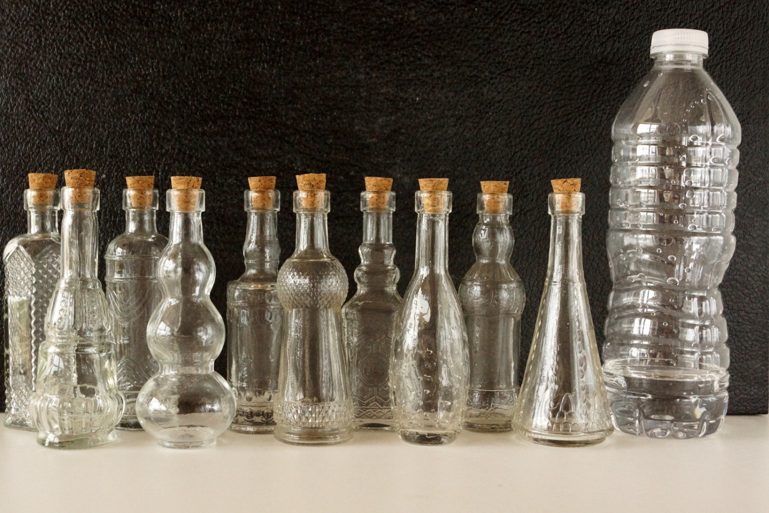 decorative clear glass bottle with cork pyramid