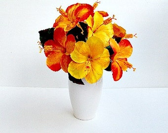 Silk Fall Floral Arrangement With Variegated Orange And Yellow Flowers In A Ceramic White Vase