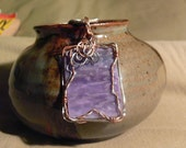 Copper and silver wire wrapped purple stained glass pendant