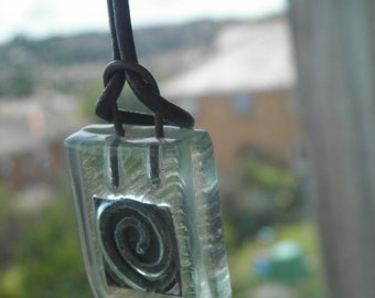 SAL Glass and metal whirl pendant with leather thong and silver metal fastening