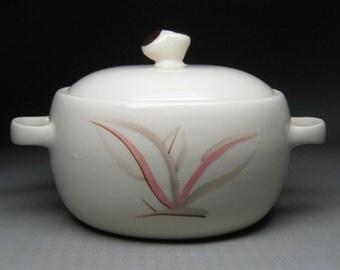 WINFIELD CHINA medium size casserole with lid , dragon flower decoration , california pottery .