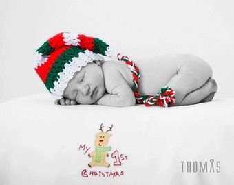 Elf-style hat in red, green and white stripes. Multiple sizes available. Made to order